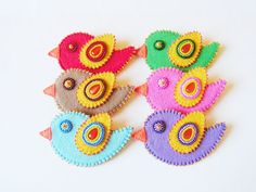 Hey, I found this really awesome Etsy listing at https://www.etsy.com/listing/130502120/bird-brooch-felt-bird-pin-bead