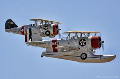 """Grumman A J2F and F3F in close formation at the Chino """"Planes of Fame """" Air Show."""