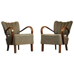 Pair of Jindrich Halabala H-237 Art Deco Armchairs | From a unique collection of antique and modern armchairs at https://www.1stdibs.com/furniture/seating/armchairs/