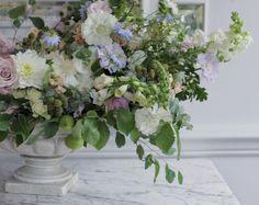 wild pastel floral table arrangement by Kent florist Jennifer Pinder. The arrangement includes blackberries, scabious, dahlias nigella, snapdragons and roses in pastel colours.