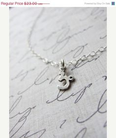 Silver Astrology Necklace by Olive Yew. Show everyone your sign with this dainty piece. #silvernecklace #astrology