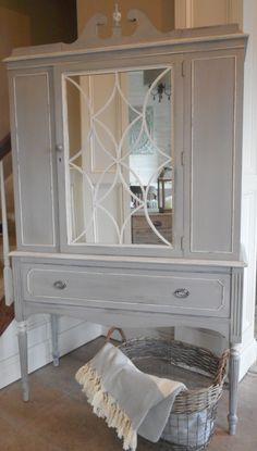 Antique China Cabinet I painted with Annie Sloan's Paris Gray and then washed with Old White.  I swapped out the glass door for a mirror so the fretwork would really pop and to create a more transitional look.