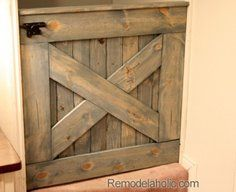 Free Plans DIY Barn Door Baby Gate for Stairs....in the process of making this....it looks awesome so far