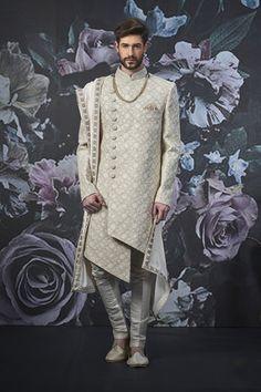 Buy Asymmetrical Groom Stylish Wedding Sherwani Online from Bodylinestore at best price. Select wide range of men's wedding sherwani, designer Sherwani for groom, traditional sherwani, jodhpuri Sherwani, sangeet sherwani and more. Sherwani For Men Wedding, Wedding Dresses Men Indian, Sherwani Groom, Wedding Dress Men, Wedding Men, Wedding Suits, Mens Sherwani, Punjabi Wedding, Indian Weddings