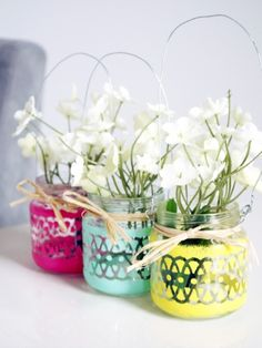 Transform empty baby food jars with pastel paints and a stencil, and hang them wherever you crave a bit of freshness.  http://www.blitsycrafts.com/2014/03/painted-mini-hanging-lanternsvases.html