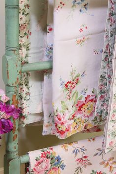 Vintage floral linens on a shabby painted rack