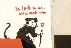 street art by Banksy.  rat.   So little to say.  000