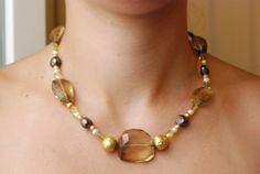 Smocked quartz, yellow tourmaline, brown pearls and gold beads made by Elisabetta di Marino on 2000.