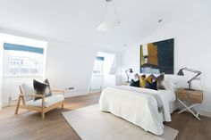 Elegantly finished, this three-bedroom terraced home has teamed original finishes with crisp white lines and contemporary accents of colour. As well as outdoor access across three floors, the house also benefits from a large formal reception room punctuated by elegant French windows onto a balcony.
