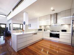 Modern open plan kitchen design using floorboards - Kitchen Photo 8931729