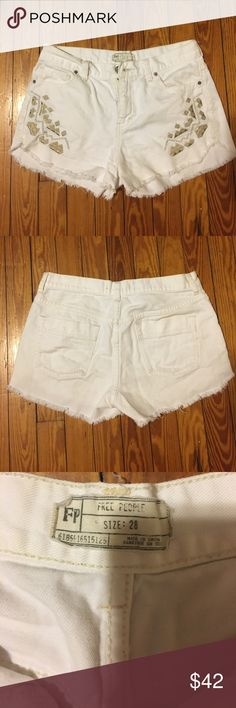 Free People high waisted shorts White denim, high waisted shorts with a gold & silver pattern under each pocket. From a pet and smoke free home! Free People Shorts