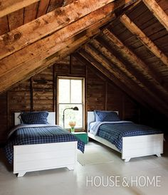 This attic bedroom is a sweet spot for guests to crash.   Photographer: Janet Kimber   Designer: Deb Nelson