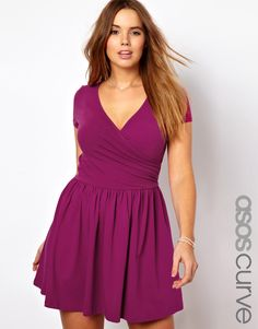 ballet wrap dress in emerald or fucsia...looks purple to me so...;D
