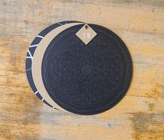 amazing round wedding invitations with grommet.  Letterpress on black paper .... so cool.