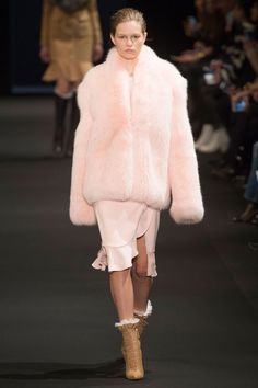 Let's talk about the fur first, like the baby-pink chubby and matching skirt with cut-away slit—perfection—and done in a longer pale-blue version if that's your preference. Or the natural fox lapels on tweedy jackets or a killer patterned moto look. Not into it the demonstrative fluff? Altuzarra brought in just touches of shearling at the collar on a schoolgirl-prim peacoat.   - HarpersBAZAAR.com