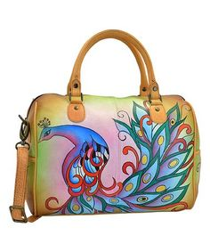 these are some of the best womens purses around.  In fact this handbag is truly trendy and very fashion forward. Easily one of the most popular purses for women #trendy #purses  This classic satchel offers a pop of personality to your ensemble via vibrantly painted leather. A wealth of handy pockets keeps you organized on the go.Royal Peacock U-Strap Hand-Painted Leather Satchel