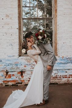 First kiss sweetness from these cuties at their vintage and rustic big day | Image by Wild Heart Visuals