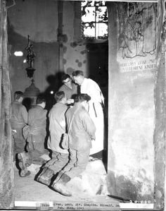 """WWII - February 26, 1945, Bliealf, Germany. U.S. Soldiers receive the Eucharist at mass in a bombed out church.  Celebrant: Assistant Division Chaplain Father Sullivan. Altar server: Michael J. Migliaccio, Fourth """"Ivy"""" Division, Army Combat Engineers.  Honor the memory of men like these U.S. Soldiers upon whose broad shoulders we in the USA have too long relied for our liberty by following their example - Faith in the Line of Duty."""