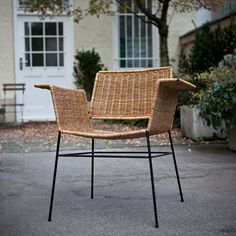 Herta-Maria Witzemann; Enameled Metal and Rattan Armchair for Wilde + Spieth, c1956.