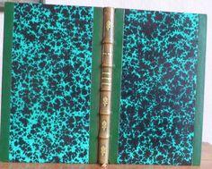 Reliure demi-cuir à bandes en cuir vert (dos passé) et papier Annonay. Livre à l'usage des écoles de dessin, des collèges, des pensions, etc. Publié à la librairie Baillère en 1880.