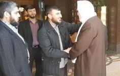 Zahran Alloush (C) i