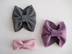 DIY Bow Cuffs by Maikitten: Beautiful and simple, my favorite kind of design. Lovely in leather, this would also be great in almost any fabric. #Bow