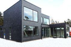 Villa Bertilsson in Västervik, Sweden. A modern villa with slate facade by architect Anders Holmberg.