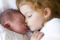 big sister and baby, siblings and baby, should I have another baby, sleeping siblings, sleeping with baby, sister kissing baby,