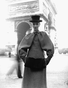 Denise Sarrault wearing Givenchy in front of Arc de Triomphe, 1955.