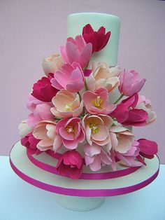 Tulip Wedding cake, three tier white fondant, pink ribbon, shades of pink sugarpaste tulips