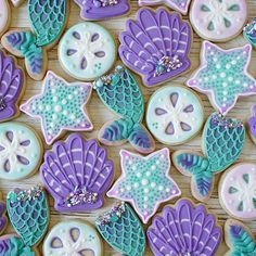 This amazing mermaid ccokie set is by @borderlandsbakery . I could just dive into this sweet ocean of sugar cookies! #itsamermaidthing #mermaidparty #babyshowerideas #birthdaygirl #cookies #cookieart #party #partyideas #littlemermaid #princess