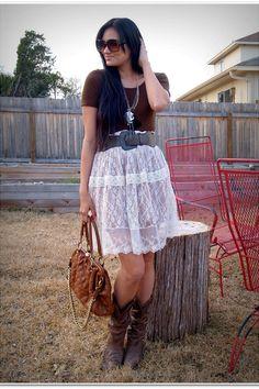 white skirt/dark top/belt matches boots