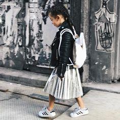 Mini school look in her favorite moto tops and plaited midi