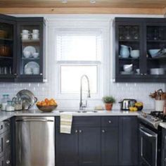 I love the ceiling with the braided jute rug beneath. I love smallish kitchens too; I miss the intimacy.