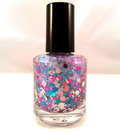 Right Round is a lovely glitter topper. Multi-size and hue blue, pink, and silver holographic and non-holo circles and hexes, and even a few light pink holo hearts mingle in a shifting blue to purple shimmer base.   Swatches show one coat dabbed over white polish and one coat over black.  Ple...