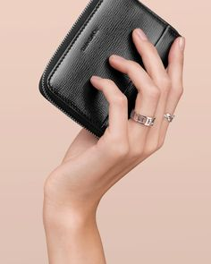 Seize the day with a little luxury. Zip card case in black textured leather. Atlas® open ring and Paloma Picasso® Olive Leaf narrow ring in sterling silver.