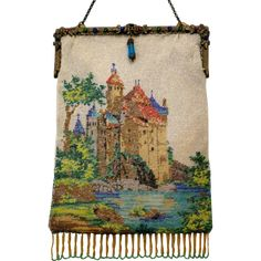 Beaded scene of an ancient Castle decorates each side of this purse and it's topped off by a wonderful jewelled frame. The sides of the bag are the