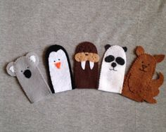If your little person loves animals, these are the finger puppets for you. This set includes a chicken, duck, cow, pig and a horse. Each finger puppet has the name of the animal embroidered on the back to help the child with word recognition. Each finger puppet is about 3 1/2 inches tall and 2 inches wide. Here is the cute little finger puppet holder!  http://www.etsy.com/listing/84744406/finger-puppet-holder-free-shipping-us    All my products are made in a smoke free, pet free home.