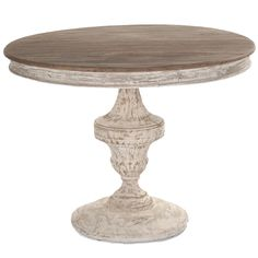 Beautiful in its simplicity, this small solid wood round French shabby chic table features a hand-carved, urn style pedestal and a heavily distressed finish. Description from bellemaisonfrancaise.com. I searched for this on bing.com/images