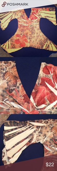 Body Central Crazy Cut Top Flowers and butterflies fly across this crazy cut v-neck top. Body Central Tops Blouses