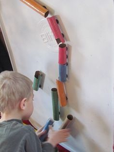 "Create changeable marble runs with sections of cardboard tubing (1 "" PVC pipe sections?), decorated, magnets hot glued to hold up."