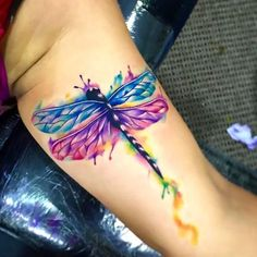Beautiful watercolor dragonfly on arm. Style: Watercolor. Color: Colorful. Tags: Cool, Amazing, Beautiful