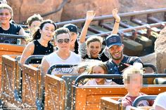 Making a splash: The gang, who were also joined by Gordon Ramsay's wife Tana and her daughter Matilda (L) were in great spirits as they raced around the Western themed ride