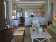 Phoebe Howard.  White kitchen open to family room.