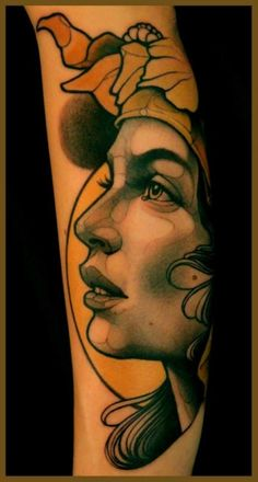 """Black & gray portrait of woman with color background and accents tattoo 