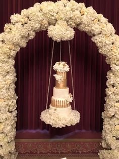 Gorgeous ivory and gold #weddingcake by Elizabeth's Cake Emporium. Floral Arch by Essential Couture.