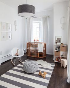 25 Creative and Beautiful Nursery Design Ideas via Brit + Co. White and natural wood nursery with an oval crib Wood Nursery, Nursery Modern, Nursery Neutral, Nursery Room, Modern Nurseries, Neutral Nurseries, Nursery Decor, Nursery Grey, Minimalist Nursery