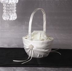 SHOP Crystal Flower Girl Baskets. Every bride is a star with the sophisticated glamour peau de soie Celebrity Flower Girl Basket adorned with pearls and genuine Swarovski crystals. Available in white or ivory.