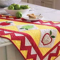 Apple of My Eye: Fast & Fun Table Runner Quilt Pattern  Designed by CHERYL ALMGREN TAYLOR Machine Quilted by PAM KOSA, fully patterned in McCall's Quick Quilts August/September 2013. Issue available for purchase in print or instant digital download at http://www.quiltandsewshop.com/category/quick-quilts/?m=categorysub_quick-quilts