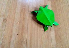 Sea turtle, designed by Toshikazu Kawasaki, folded by Teru Kutsuna.